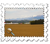 Aircraft at Tarbes Airport with the Pyrenees in the background