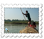 If not exactly on the high seas at Chitwan, we were impressed that the ferryman had time to make a call...