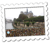 A bizarre view of Notre Dame seen from a bridge of padlocks